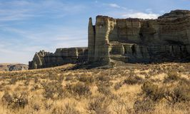 Cliffs in desert in Oregon. Colorful mudstone cliffs at the Pillars of Rome in the high desert of eastern Oregon Royalty Free Stock Photos