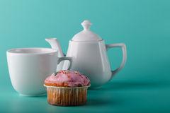 Colorful muffin with flower. Aqua color background Royalty Free Stock Images