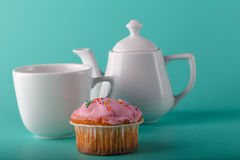 Colorful muffin with flower. Aqua color background Stock Photo