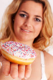 Colorful muffin in hand Royalty Free Stock Photo