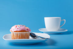 Colorful muffin on saucer Royalty Free Stock Photography