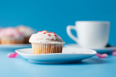 Colorful muffin on saucer with flower petal Stock Photo