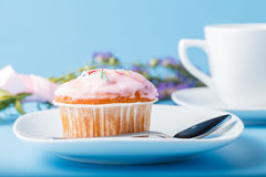 Colorful muffin on saucer with flowers Stock Images