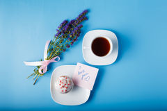 Colorful muffin on saucer with flowers. Note with  message Stock Photos