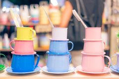 Colorful mugs stainless steel royalty free stock image