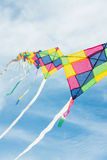 Colorful multi-color kites flying in blue sky Stock Image