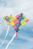 Colorful multi-color kites flying in blue sky Royalty Free Stock Images