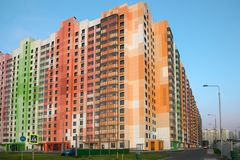 Colorful multi-storey residential apartment building. On a summer evening royalty free stock photos