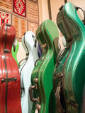 Colorful multicolor Cello Carrying Cases Standing On Display Stock Photo