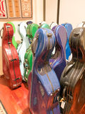 Colorful multicolor Cello Carrying Cases Standing On Display Stock Images