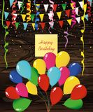 Colorful multicolored confetti and garland of flags and balloons. Holiday birthday.Yellow sheet of paper for notes. Sticker. Vector on wooden background Royalty Free Stock Photos