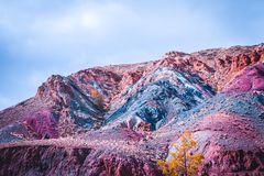 Colorful multicolored hills and canyons in red tone. Autumn mood in the mountains royalty free stock photography