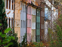 Colorful multistory homes cityscape Augsburg. The colorful facades of multistory homes in the city of Augsburg in Bavaria, Germany at the park Stadtgraben Royalty Free Stock Images