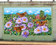 Colorful Mural Of House Surrounded by Flowers and Butterflies On James Road in Memphis, Tennessee. royalty free stock photo