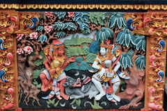 Colorful mural of Ramayana Hindu myth in Bali. Colorful mural of characters from Ramayana myth on wall of Balinese Temple stock photos