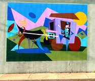 Colorful Mural of A Stage Coach and Driver On James Road in Memphis, Tennessee. Beautiful local artist rendering of man standing beside a stage coach and horse Royalty Free Stock Images