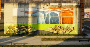 Colorful murals at the park. A wall full of color and graffitis Royalty Free Stock Photo