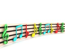 Colorful musical clefs Stock Images