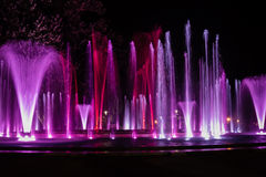 Colorful musical fountain Stock Images