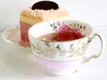 Colorful n yogurt cake and beautiful roses tea cup made with bone chiana. Selective focus Stock Photo