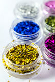 Colorful nail glitters  on white background. Stock Images