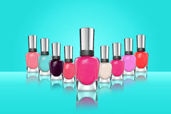 Colorful nail polish on blue background Stock Photos