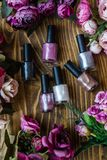 Colorful Nail Polish Bottles on Brown Wooden Background stock photography