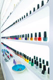 Colorful nail polish colors in a row at nails saloon on white Royalty Free Stock Photo