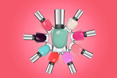 Colorful nail polish on pink background Stock Image