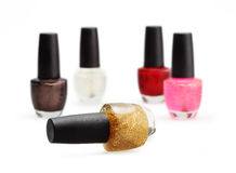 Colorful nail polish set on white background isolated Royalty Free Stock Images