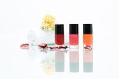 Colorful nail polishes Stock Photos