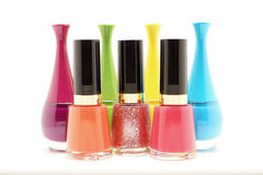 Colorful nails polish bottles on white background Stock Image