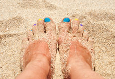 Colorful nails in the sand Royalty Free Stock Images