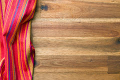 Colorful napkin on wooden table Royalty Free Stock Image