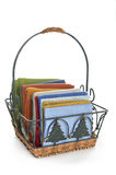 Colorful napkins in decorative basket Royalty Free Stock Image