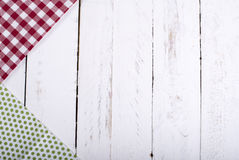 Colorful napkins on a white wooden board Royalty Free Stock Image