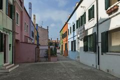 Colorful narrow street in Burano island Stock Images