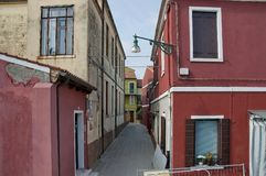 Colorful narrow street in Burano island Royalty Free Stock Photography