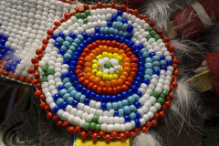 Colorful Native American Indian Beads with a Star Pattern. A macro photo of Native American Indian style bead work with a star pattern and a circular pattern.  I Stock Image