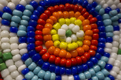 Colorful Native American Indian Beads with a Star Pattern. A macro photo of Native American Indian style bead work with a star pattern and a circular pattern.  I Royalty Free Stock Image