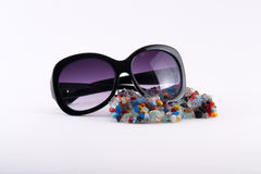 Colorful natural crystal stones and sun glasses Royalty Free Stock Image