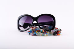Colorful natural crystal stones and sun glasses Royalty Free Stock Images
