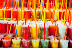 Colorful natural fresh fruits juice glasses with straw Stock Photo