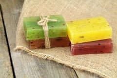 Colorful natural herbal soaps on burlap Royalty Free Stock Image