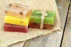 Colorful natural herbal soaps on burlap Stock Photo