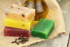 Colorful natural herbal soaps on burlap Stock Photo