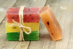 Colorful natural herbal soaps on old wood Stock Image