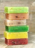 Colorful natural herbal soaps on old wood Royalty Free Stock Image