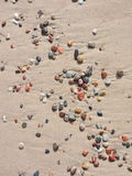 Colorful natural stones on sand Royalty Free Stock Image
