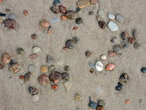 Colorful natural stones on sand Stock Photos